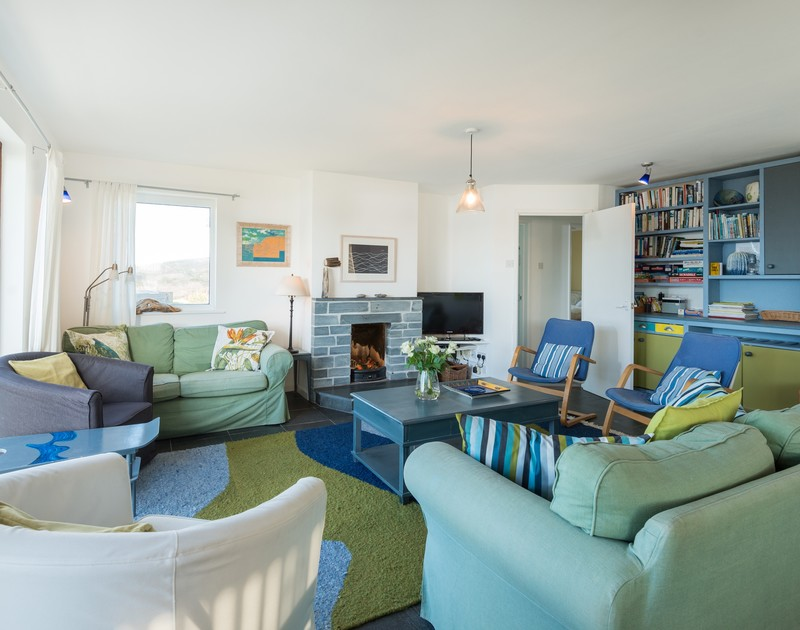 The living room with fire place at Upper Gren self catering holiday home in Daymer Bay, North Cornwall.