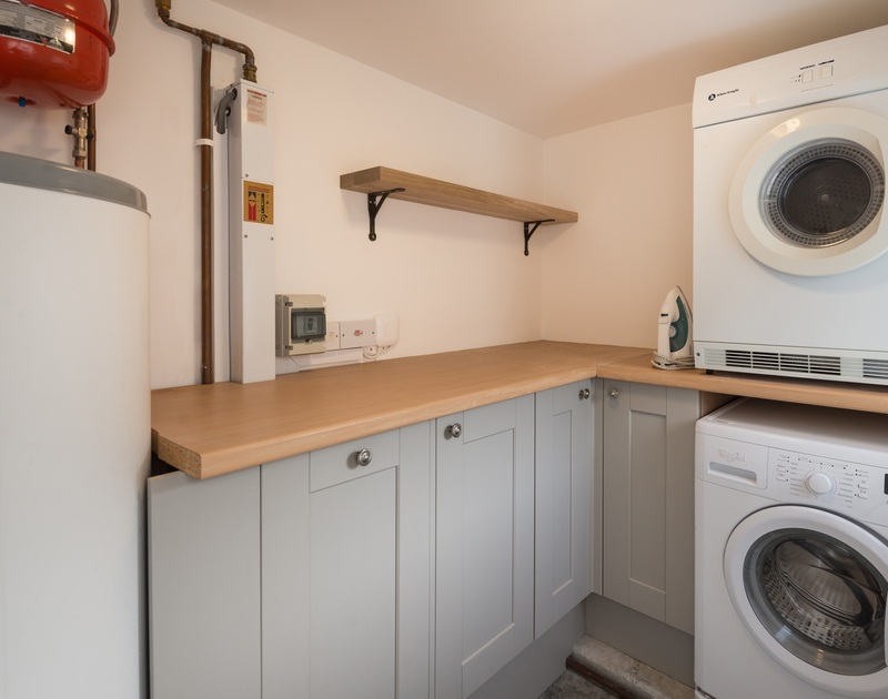 The utility room at Kipper Cottage self catering holiday home in Port Isaac, North Cornwall.