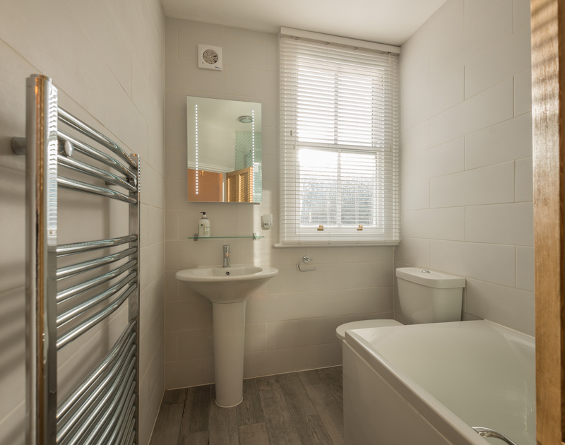 The family bathroom at Kipper Cottage self catering holiday home in Port Isaac, North Cornwall.