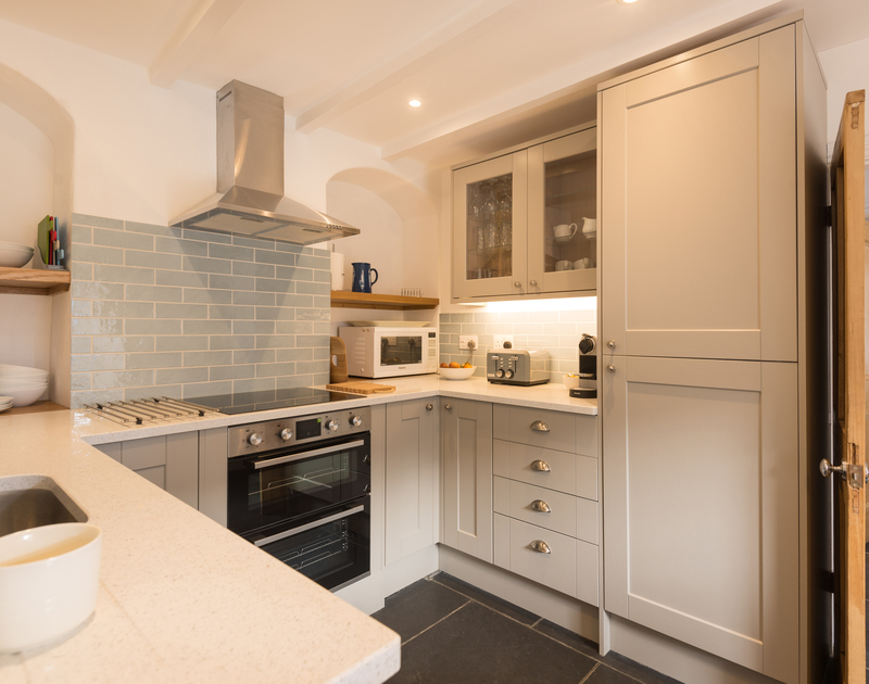 The well-equipped kitchen at Kipper Cottage self catering holiday home in Port Isaac, North Cornwall.