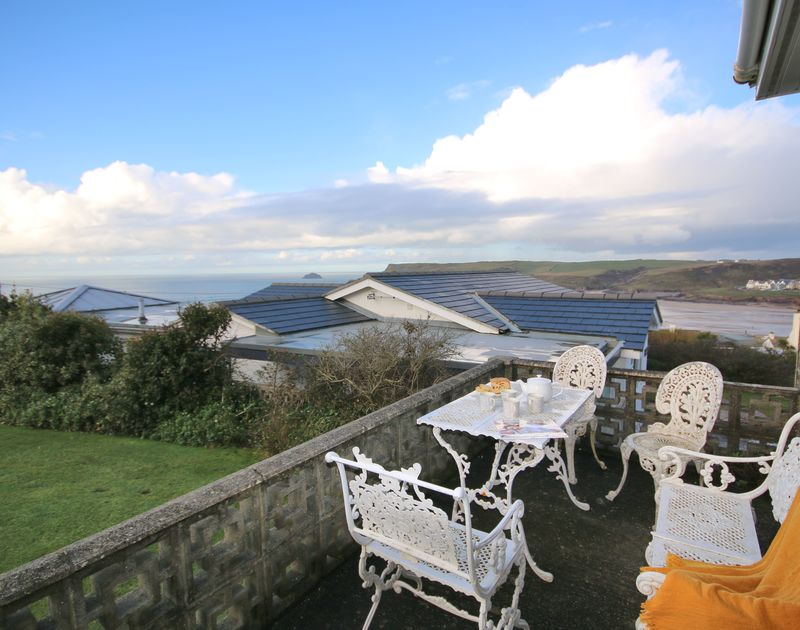 The patio with sea views over Polzeath beach at Little Buckden self catering holiday home in Polzeath, North Cornwall.