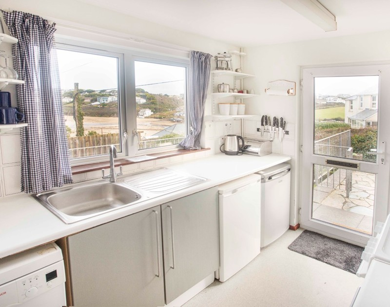 The well-equipped kitchen with sea views at Millbank self catering holiday home in Polzeath, North Cornwall.