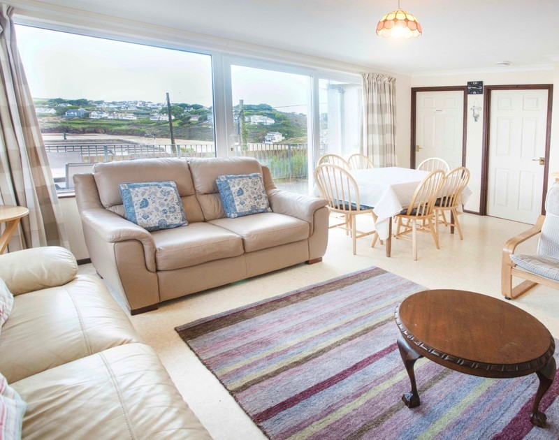 The living room with sea views at Millbank self catering holiday home in Polzeath, North Cornwall.