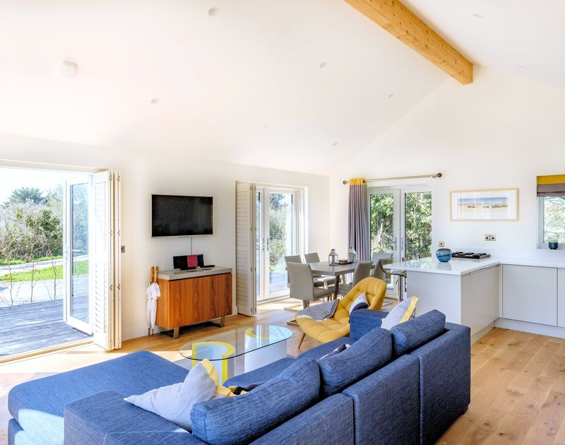 The open plan light filled kitchen, living and dining room at Zeath self catering holiday home in Rock, North Cornwall.