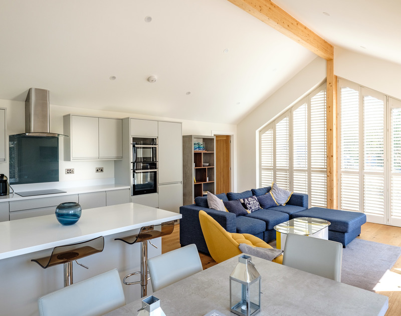 The open plan kitchen, living and dining area at Zeath self catering holiday home in Rock, North Cornwall.
