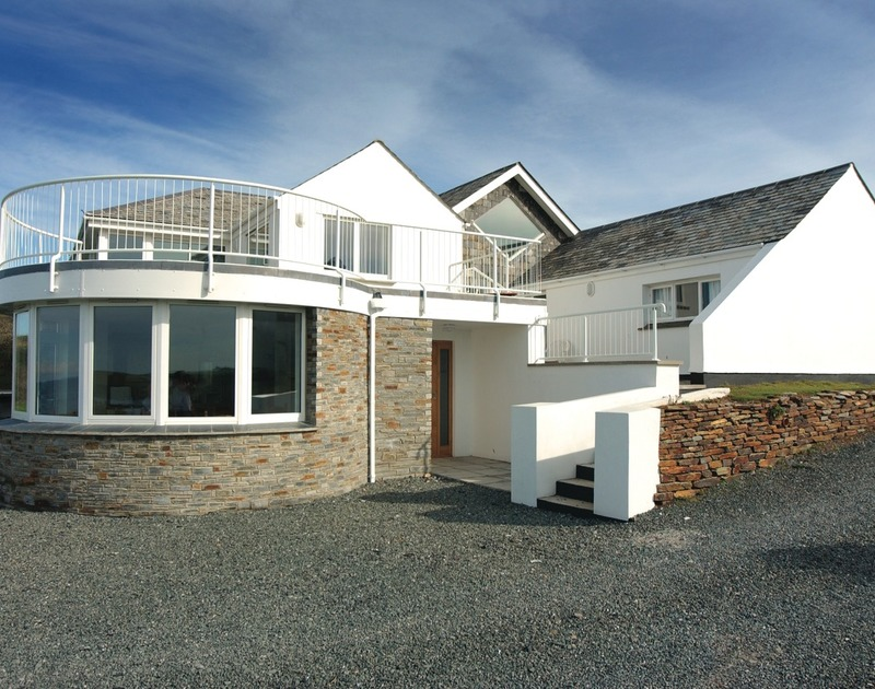 The exterior of Splits, a holiday house near Daymer Bay, Cornwall, with its spacious driveway