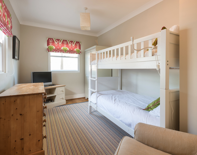 The bunk bedroom at Lowenna Manor 8 self catering pet friendly holiday home in Rock, North Cornwall.