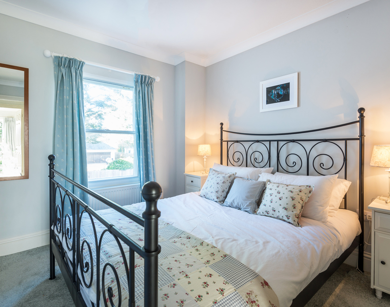 The comfortable king bedroom at Lowenna Manor 8 self catering holiday home in Rock, North Cornwall.