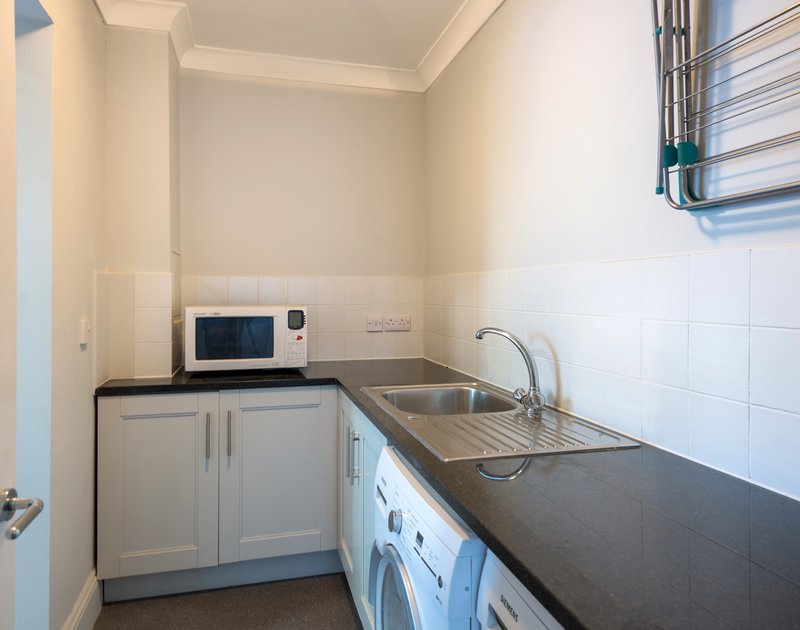 The useful utility area with wet room at Lowenna Manor 8 self catering holiday home in Rock, North Cornwall.