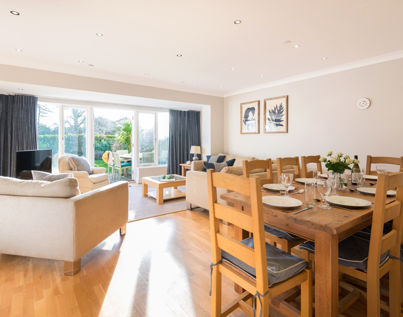 The open plan kitchen, dining and lounge area at Lowenna Manor 8 self catering holiday home in Rock, North Cornwall.