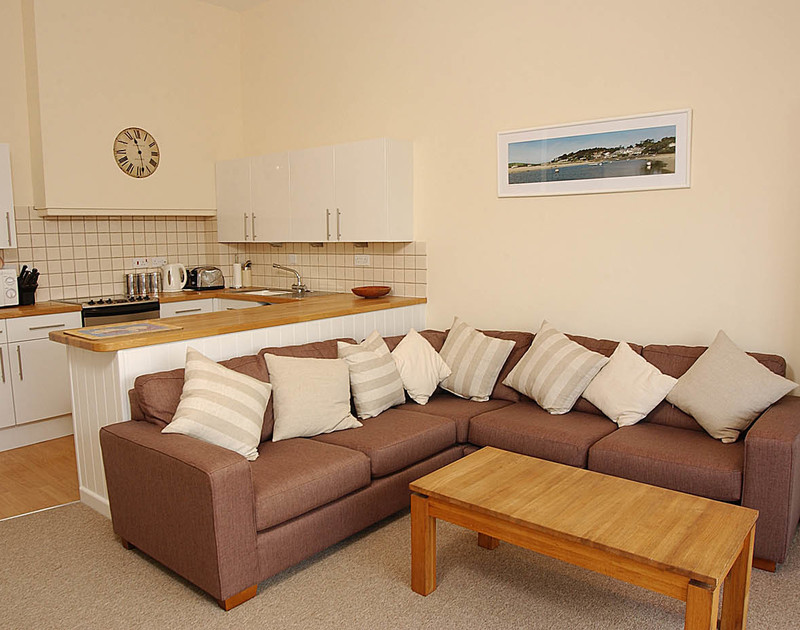 Attractively furnished lounge and kitchen of Slipway 9, holiday house in Rock, Cornwall