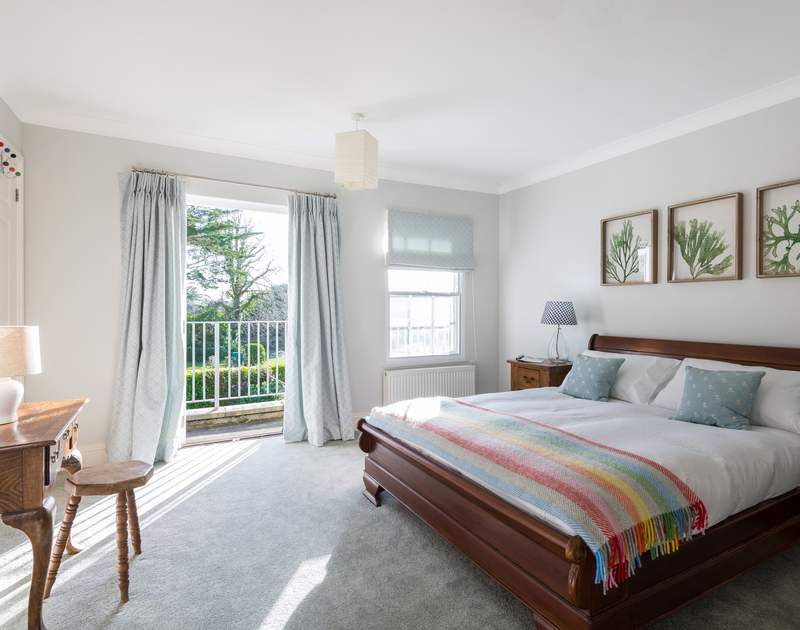 The master bedroom with ensuite and balcony at Lowenna Manor 8 self catering holiday home in Rock, North Cornwall.