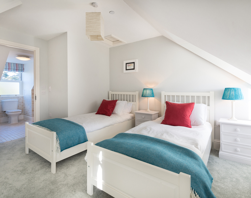 The top twin bedroom with ensuite at Lowenna Manor 8 self catering holiday home in Rock, North Cornwall.