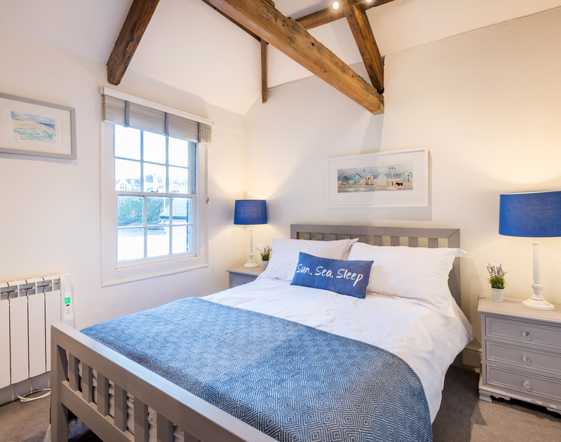 The peaceful master bedroom with sea views at Morley's Cottage self catering holiday home in Port Isaac, North Cornwall.