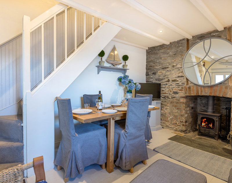 The cosy living room with extendable dining room table and log burner self catering holiday home in Port Isaac, North Cornwall.