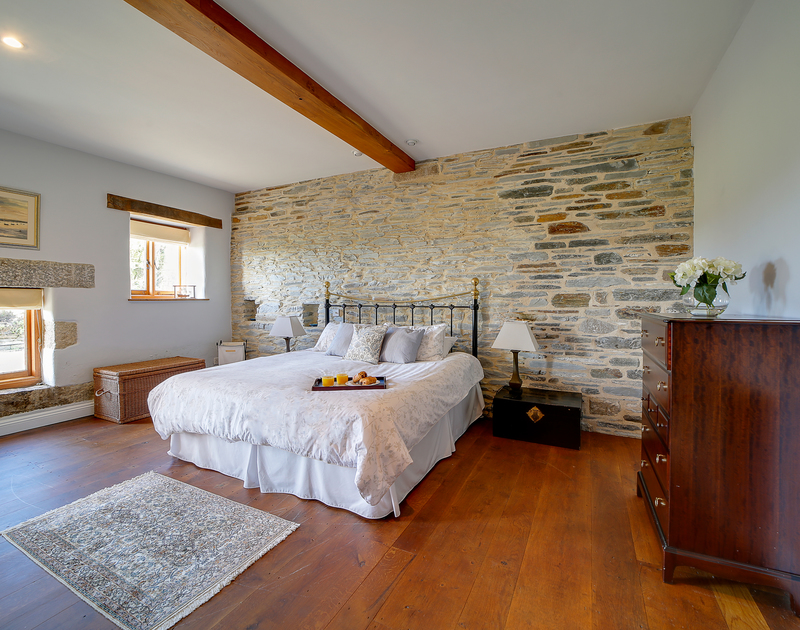 One of the ground floor double rooms with views across the gardens and traditional stone walls.