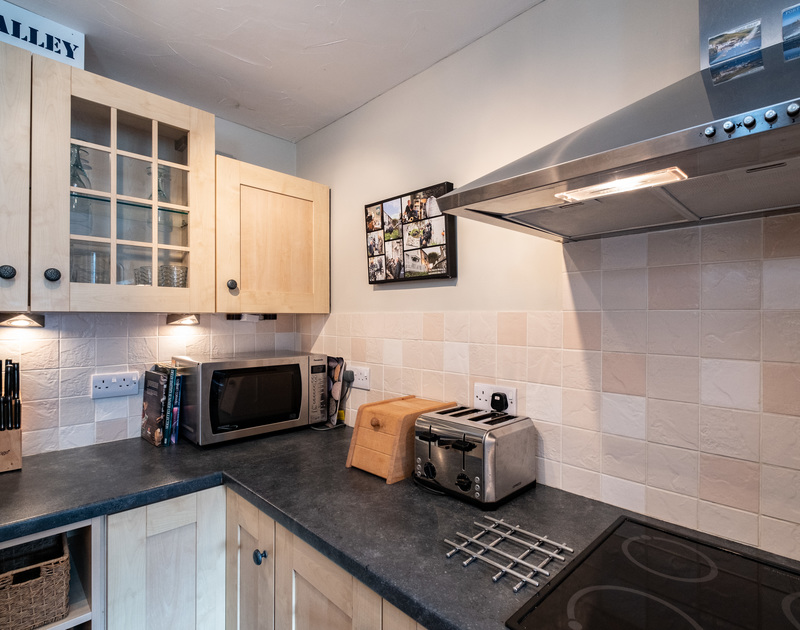 The worktop and kitchen cupboard of Homelands in Port Isaac
