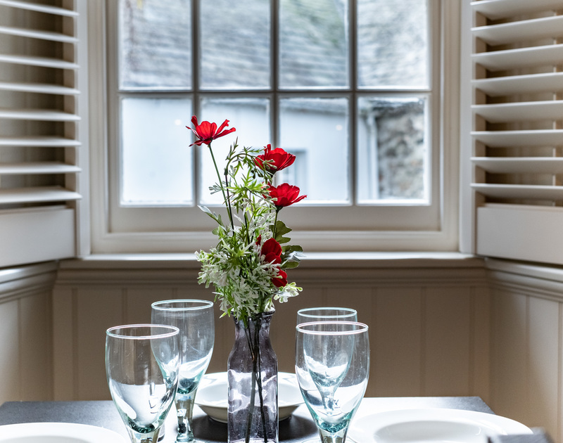 The dining table at Homelands, self-catering holiday cottage in Port Isaac, looking onto Dolphin Street