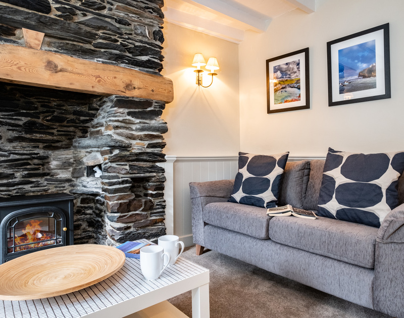 Soft carpet flooring, sofa and coffee table in the living room of self-catering cottage Homelands in Port Isaac