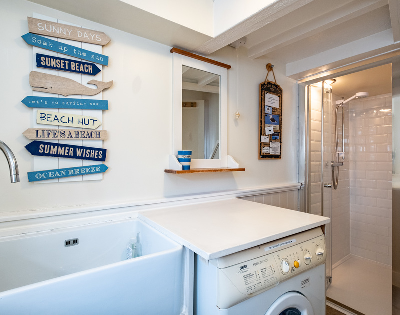 The downstairs bathroom/utility room and it's walk-in shower in Homelands, Port Isaac