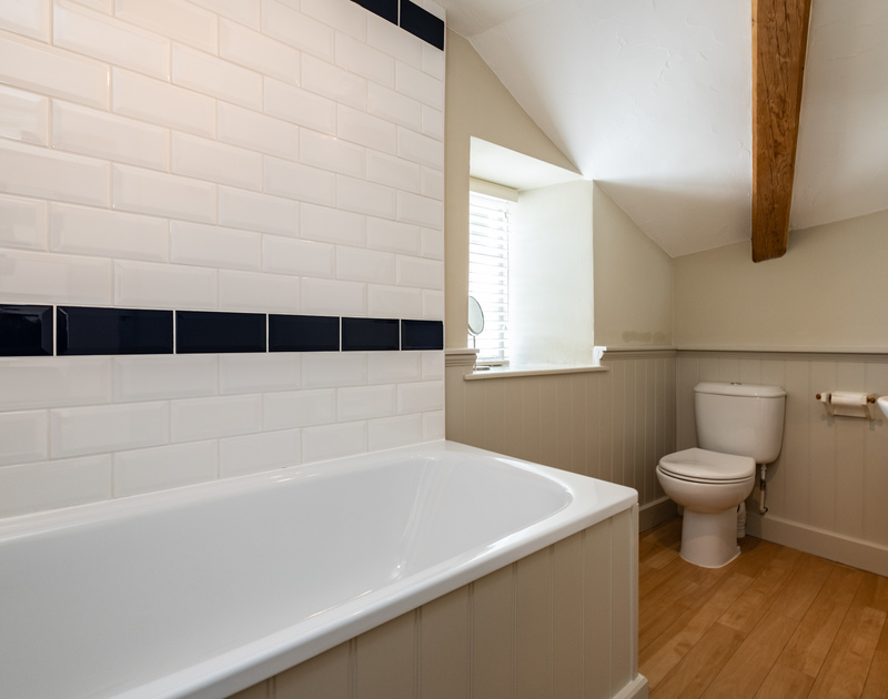 The master-bedroom en-suite of Homelands in Port Isaac, complete with bath, loo and sink.