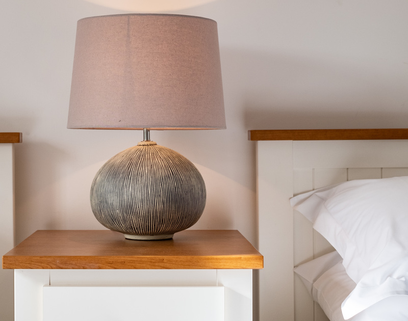The stylish bedside lamp between the twin beds at Homelands in Port Isaac