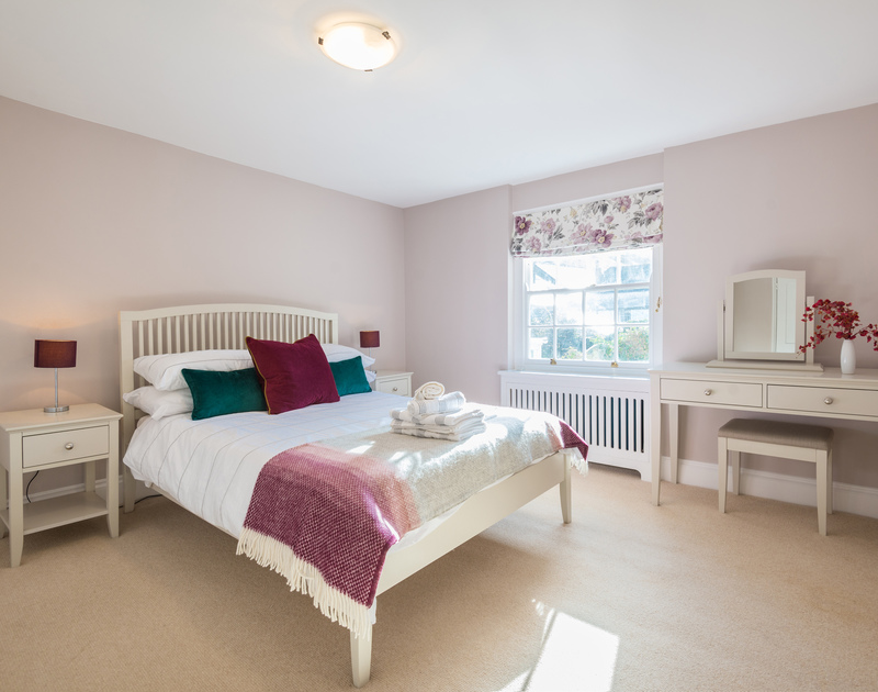 The well-styled first floor double bedroom of Trevan House