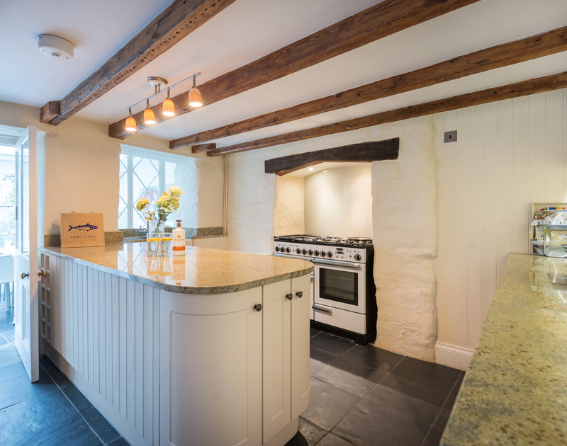 The contemporary kitchen with characterful wooden beams at Trevan House, Port Isaac