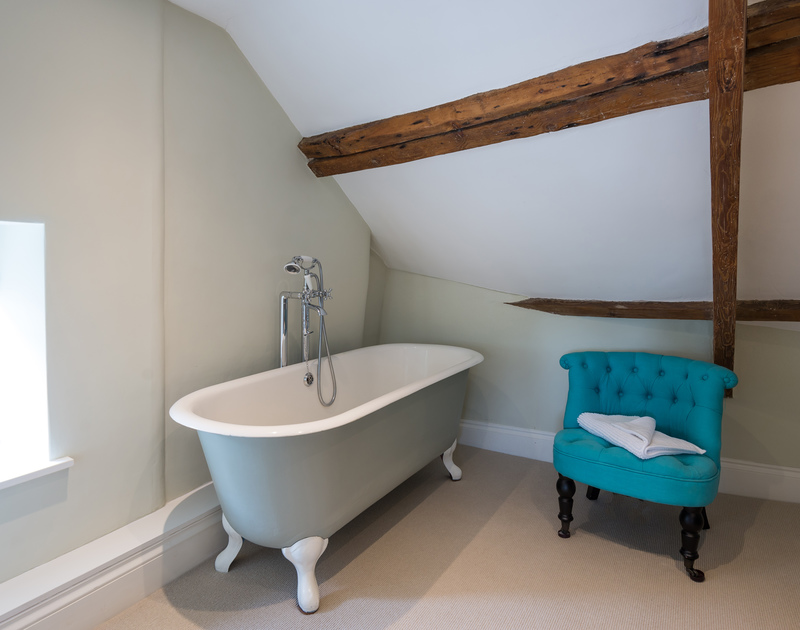 The private claw-foot bath just off the masterbedroom