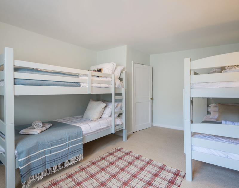 The double-bunk bedroom of Trevan House, with full-sized single beds