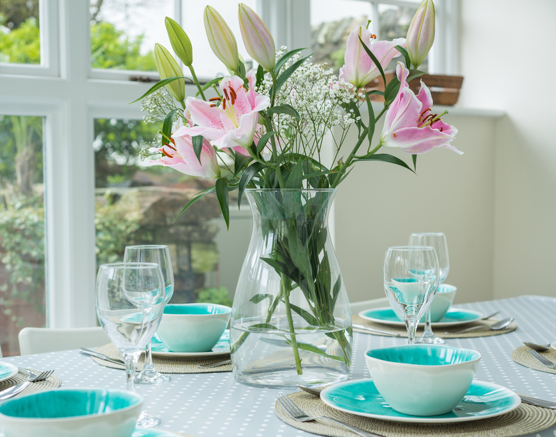 Flowers dress the dining table of Trevan House