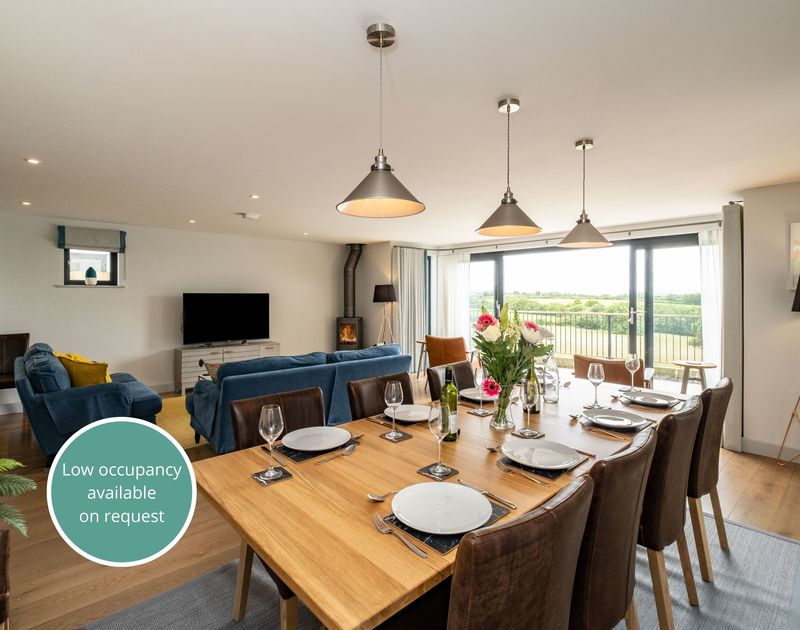 Tor View's open plan living and dining area with access to patio, in Rock, self catering property in North Cornwall.