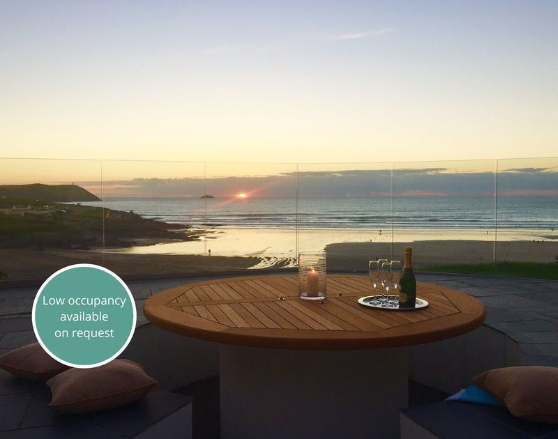 Catch the last of the glorious sunsets from the sunken patio area at the Whitehouse in Polzeath with its built in BBQ and glass balustrade.