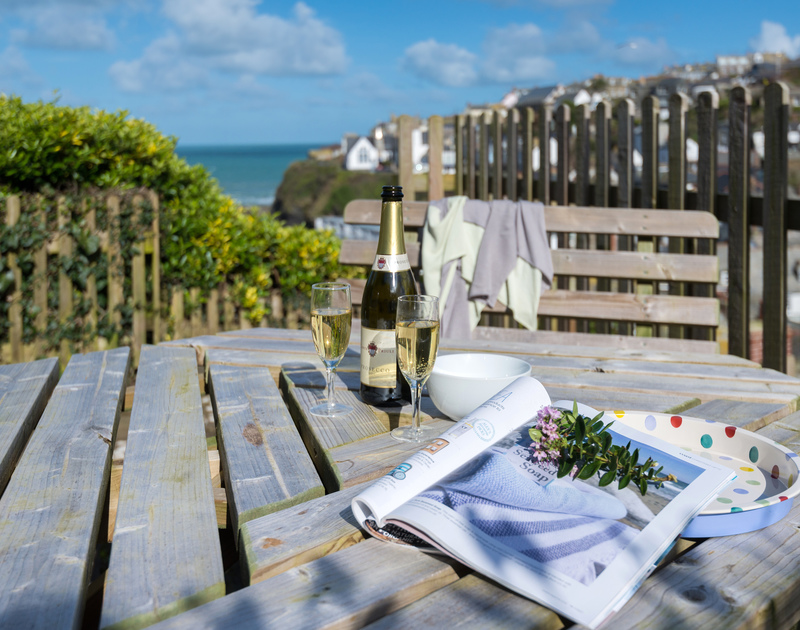 Enjoy a relaxing drink, with a beautiful view across the old harbour and gentle sea breeze, from the middle terrace of Scuppers self-catering holiday cottage, Port Isaac