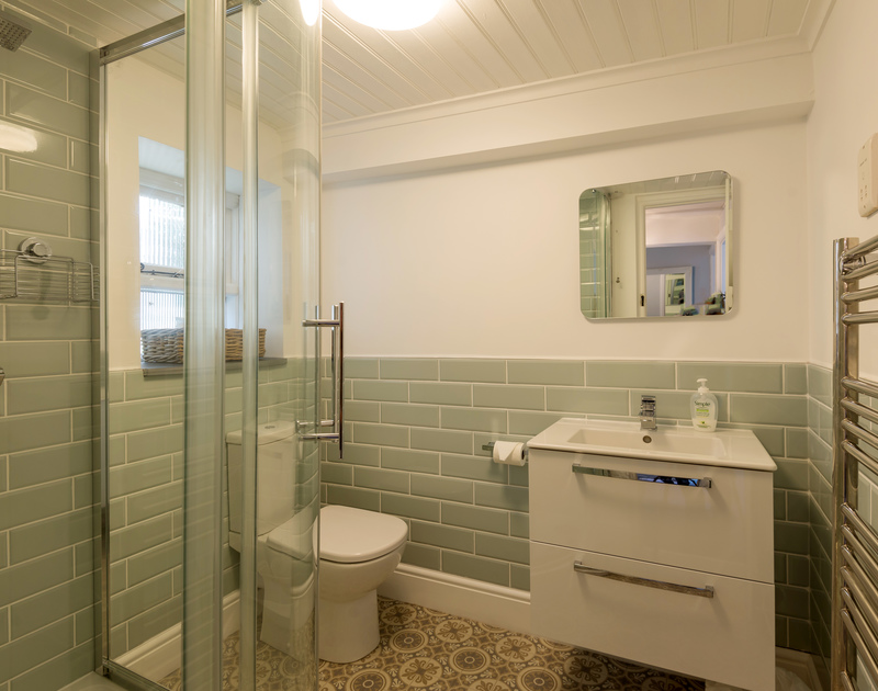 Enjoy a refreshing shower in the family bathroom after a long day at the beach at Scuppers, Port Isaac