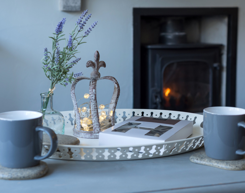 Have a cosy cup of tea in front of the fire at Scuppers, self-catering holiday cottage, in Port Isaac