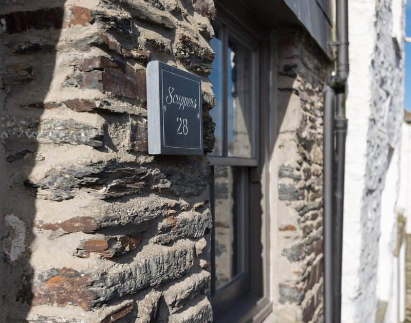 A traditional local slate sign for Scuppers, 28 Church Hill, Port Isaac