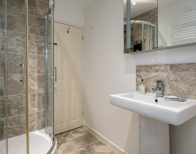 The tall walk-in shower in the family bathroom of Stokes Cottage