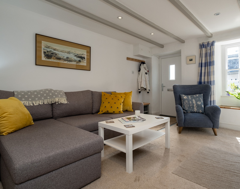 Relax into the sofa and enjoy the comfort of the softly furnished living room after a long day exploring the North Cornish coast at Stokes Cottage