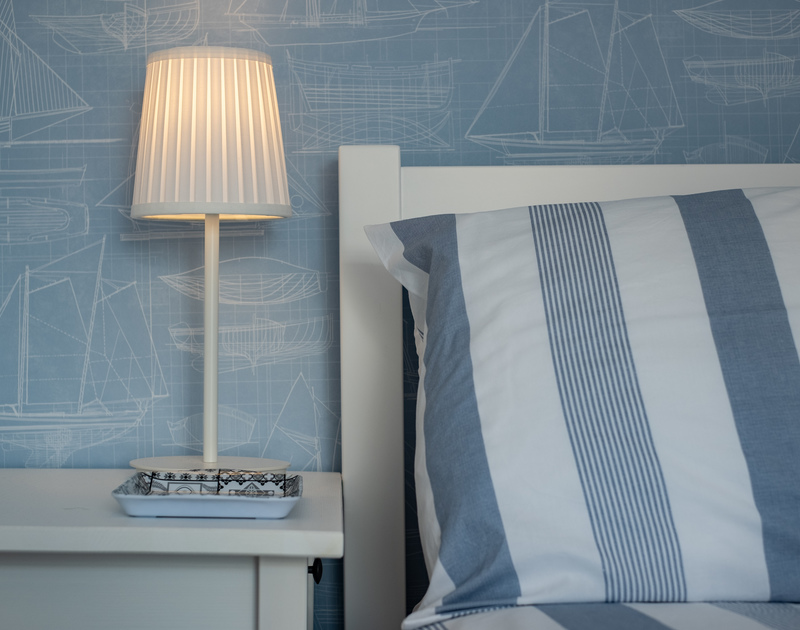 A glimpse of the nautical wallpaper in the master bedroom at Stokes Cottage