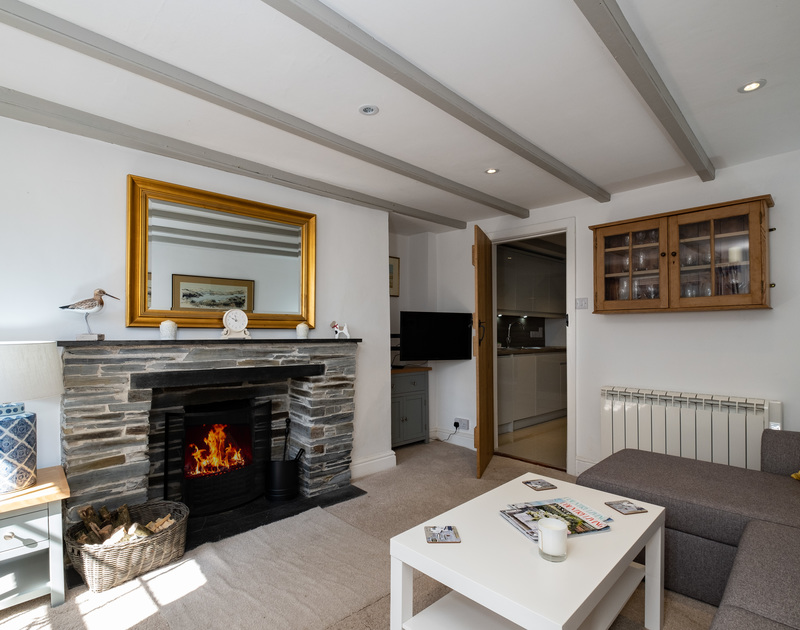 Enjoy a warming fire at the end of a long day in the living room of Stokes Cottage