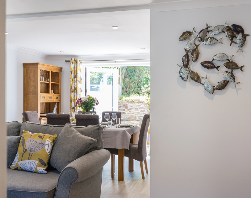 A peek inside the open-plan living/dining area of Stop Tide from the hallway