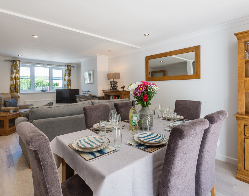 Dining table set and ready for a family meal at Stop Tide, all the more enjoyable with these soft & cushioned dining chairs...keep the courses coming!