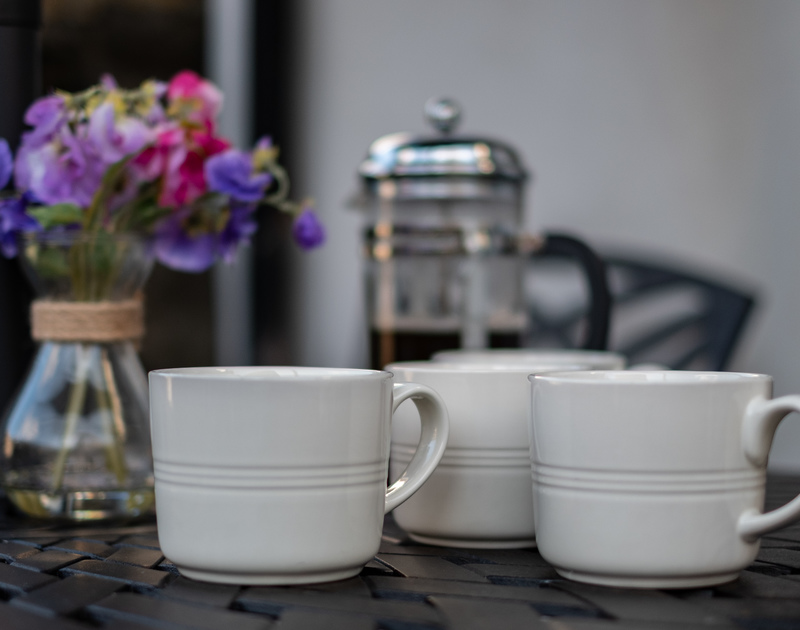 Relax with a coffee outside at Kipper Cottage