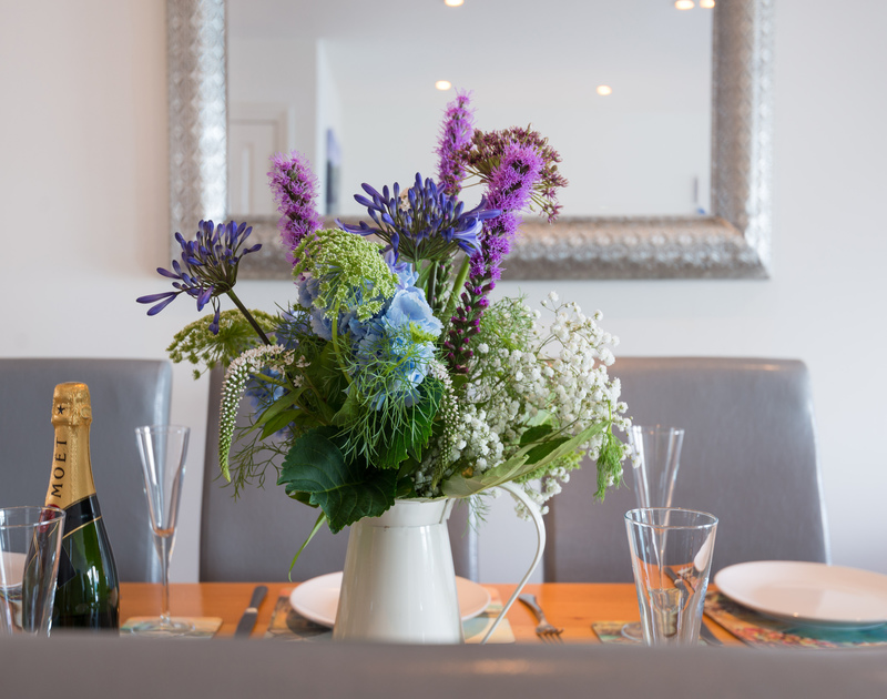 Lovely fresh flowers adorn the dining table of Ocean Breeze, perfect with Moet...