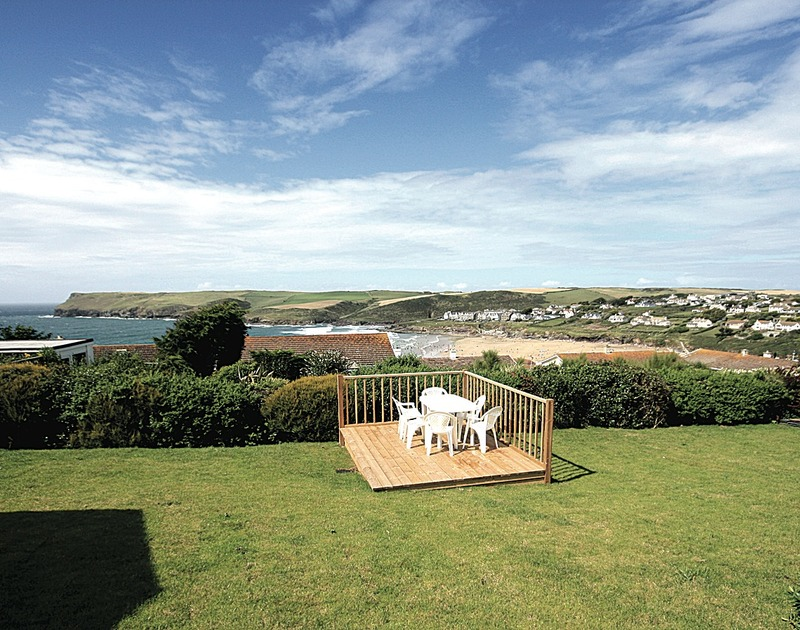 The garden and decking area with far reaching sea views towards Pentire point from Trevic, a self catering holiday rental  in a fabulous location on the cliffs above Polzeath on the North Cornish Coast.