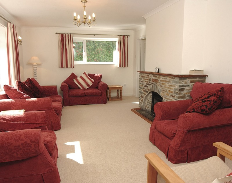 The comfortable sitting room of Medway, a holiday rental in Rock, Cornwall, with matching sofas and armchairs.