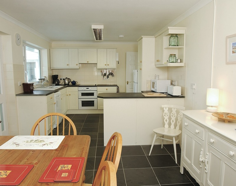 The smart cream and black kitchen/diner of Medway, a holiday house in Rock, Cornwall