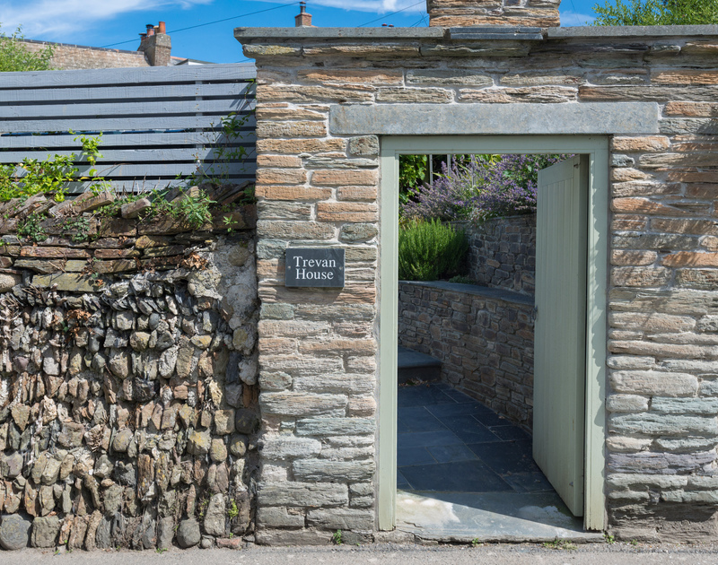 The lovely old stonewall and garden entrance for Trevan House, at the back of the property