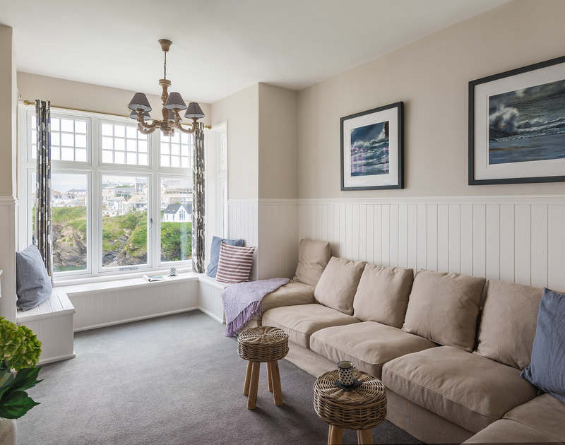 The striking bay window floods the living room with light at Folly 2 in Port Isaac
